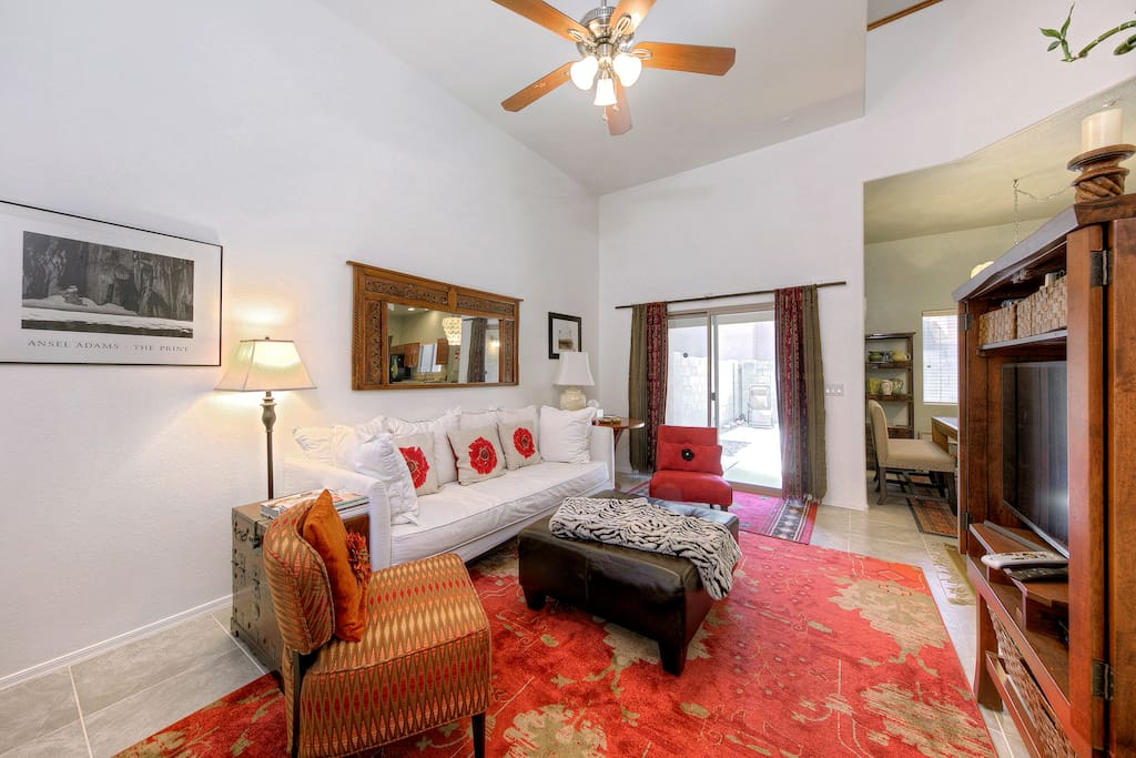 The spacious and newly renovated living room boasts airy vaulted ceilings.