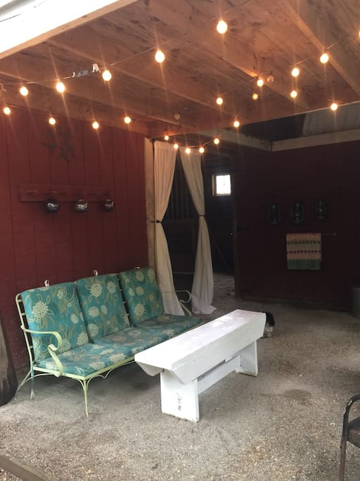 Den area.  Enjoy your morning coffee or evening glass of wine inside the covered porch area.