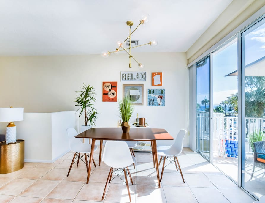 Comfortable, stylish and  modern dining room to enjoy a delicious meal while taking a break from the sunny beach!