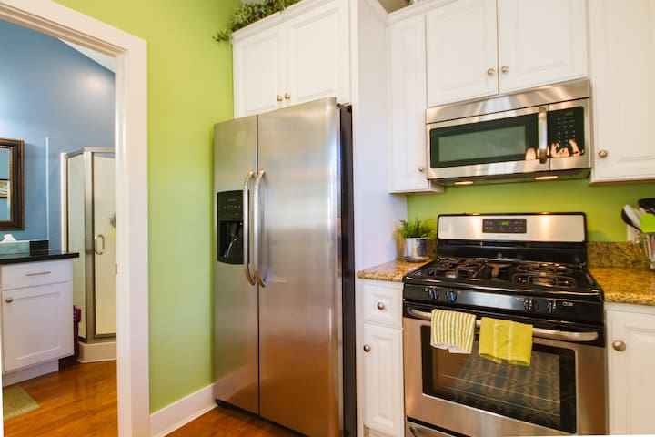 Full kitchen~ fridge, stove, oven, microwave (no dishwasher).
