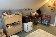 In your kitchenette you have a mini fridge stocked with waters, a keurig, and snacks. There is also a microwave and silverware.