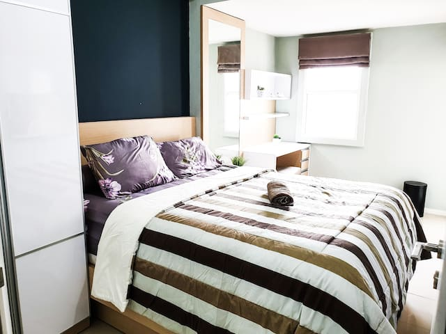 Each bedroom is beautifully furnished. There is a TV Cable inside, wardrobe, and working desk in this bedroom. Extra floor matrass can be put inside this room too.  Please input the correct number of guests before booking.  #1 bed : 160 x 200