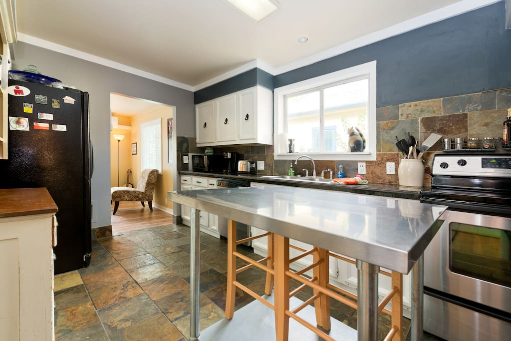 Travertine floors, granite counters and cozy eating area.