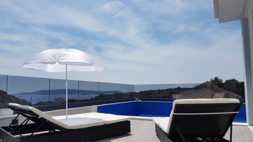 A view from the pool at the top of the house