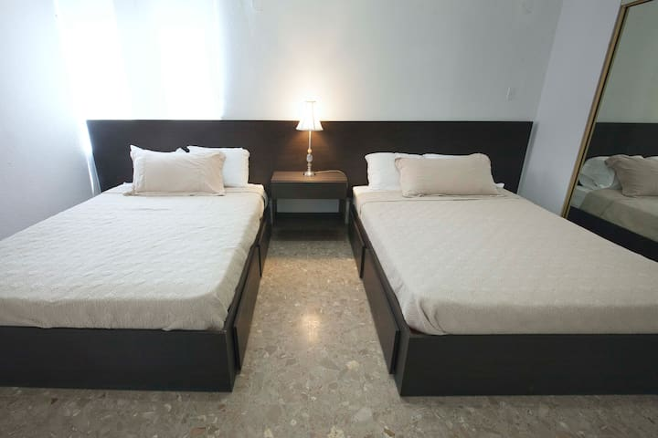 BEDROOM WITH TWO QUEEN SIZE BEDS, AC
