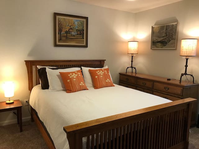 Cozy (2nd ) zen-like bedroom with sleigh bed and landscape art.