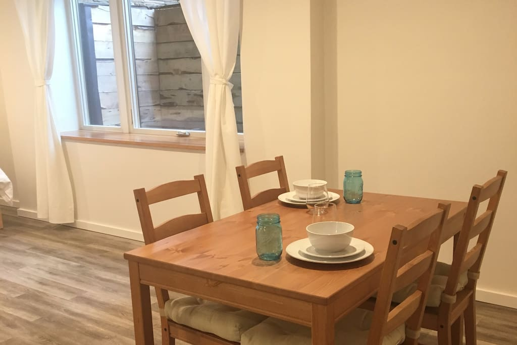 Use the dining room table for meals at home or desk work with nice natural light
