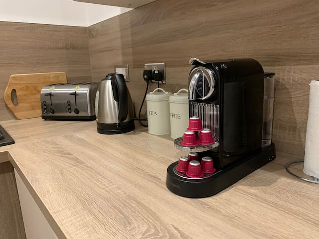 Nespreso coffee machine for your use with complementary coffee pods for you're use.