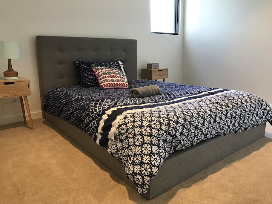 Generally sized bedroom with brand new furnitures and accessories.