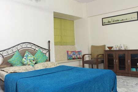 Spacious AC room near airport in leafy locality