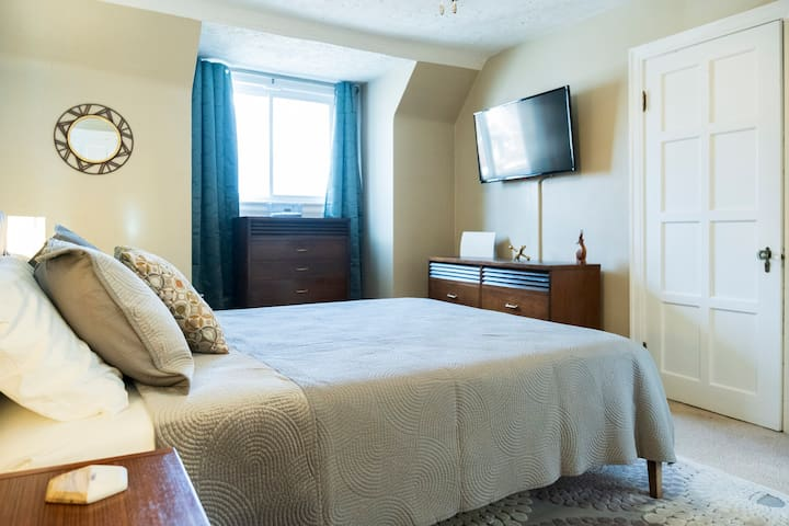 Master bedroom with queen bed,  smart TV,  and full closest for guest use.  USB outlets on each side table.