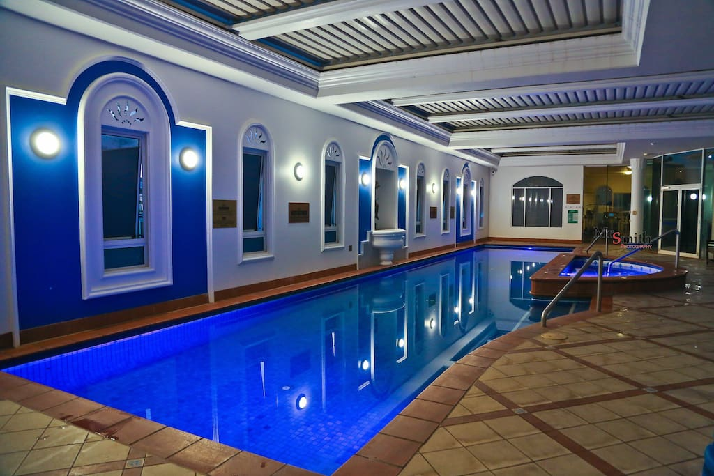 Indoor heated pool & spa. Gym is at the far end of photo