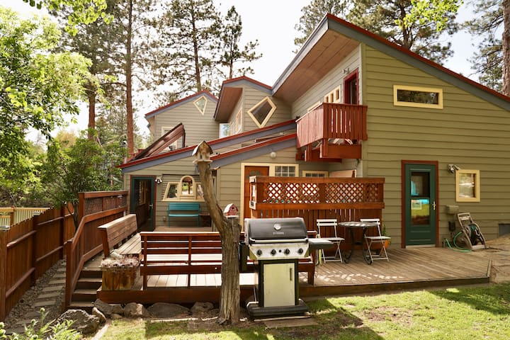 Back side of home. Shared grill, hot tub, lower decks and garden