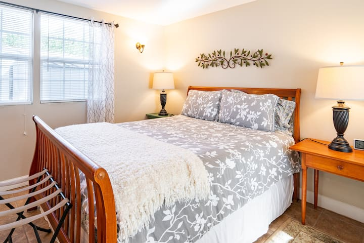 Comfy Queen sized bed with soft 100% cotton sheets and duvet