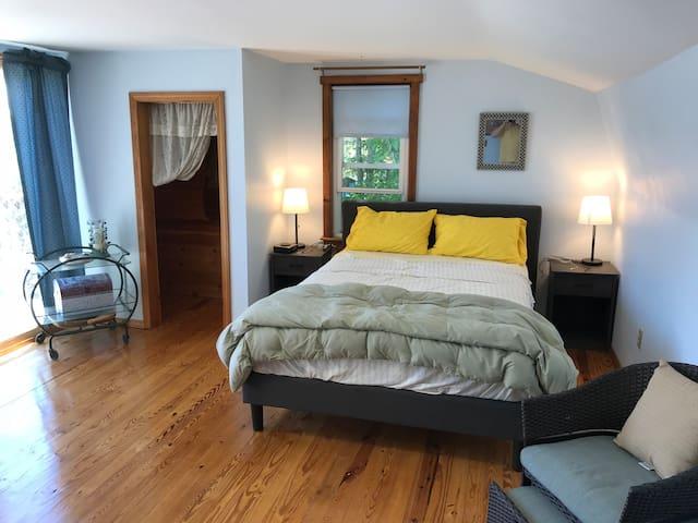 Master bedroom (with balcony overlooking Pushaw Lake).  :-)