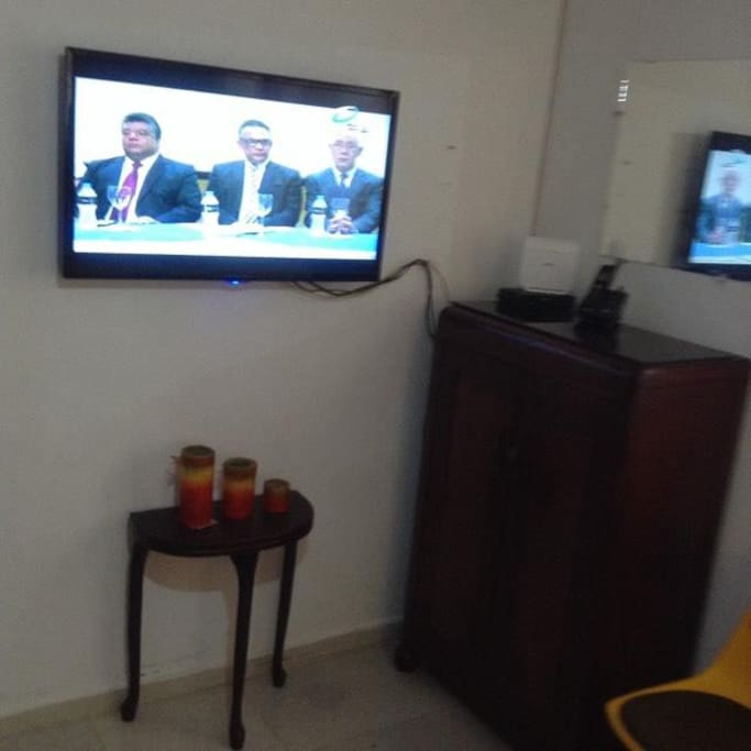 TV and Cabinet in Bedroom