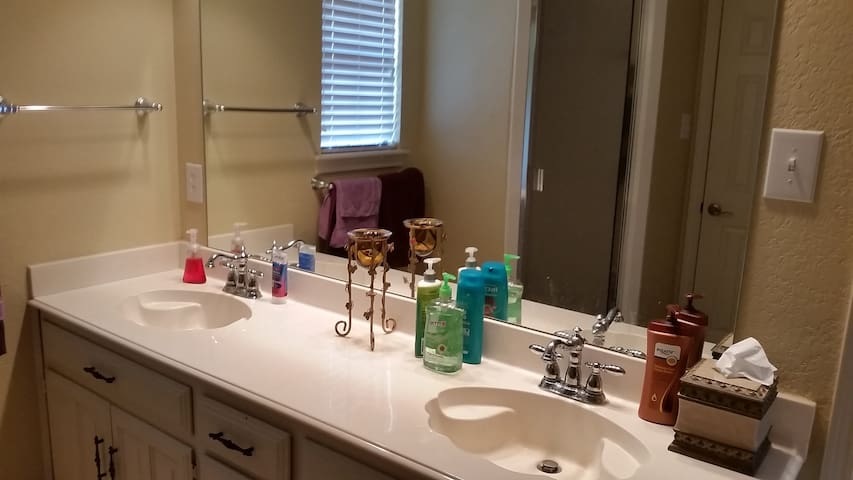 well lit bathroom with great shower and your own sink. Plenty of clean towels, toiletries and personal drawers for your own items
