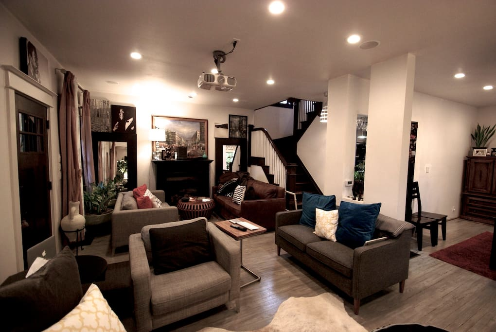 Wide angle photo of living room with stairs