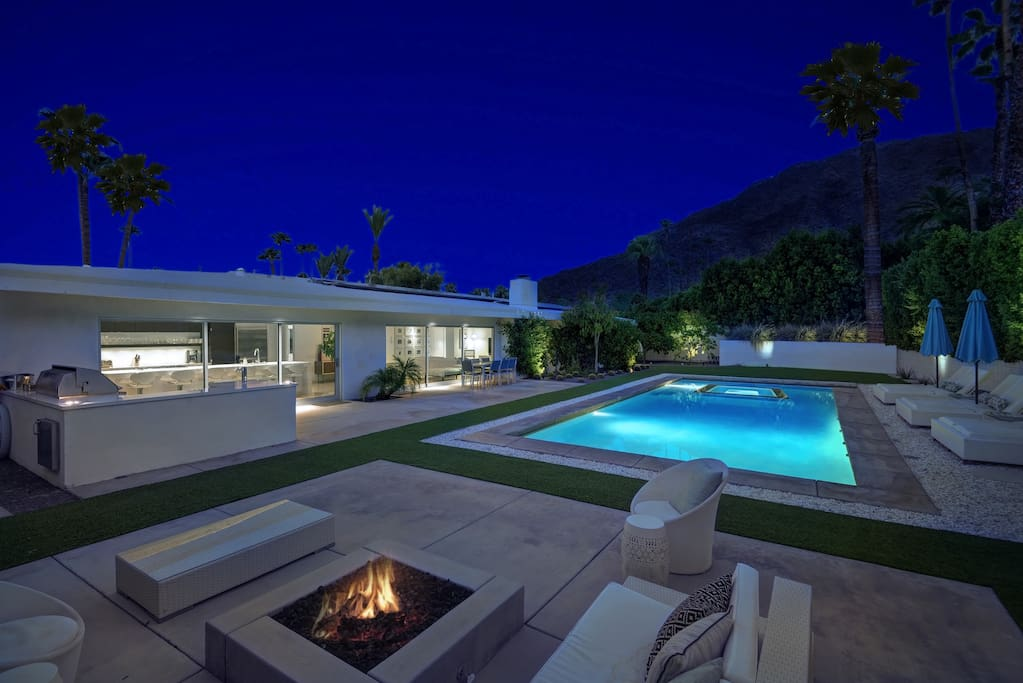 In the evening, gather around the outdoor fireplace or go for a night-time dip.