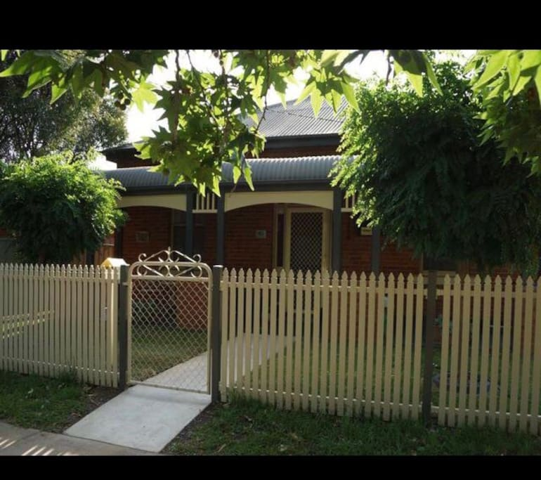 The classic picket fence, leafy mop top trees and a classic bullnose verandah greets you.