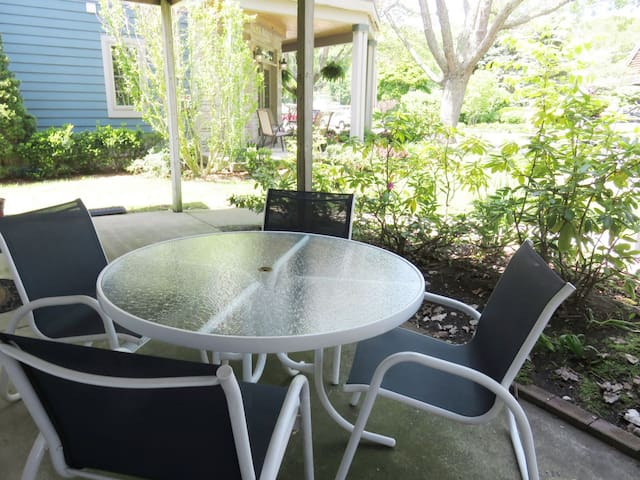 Outside patio with a table and chairs