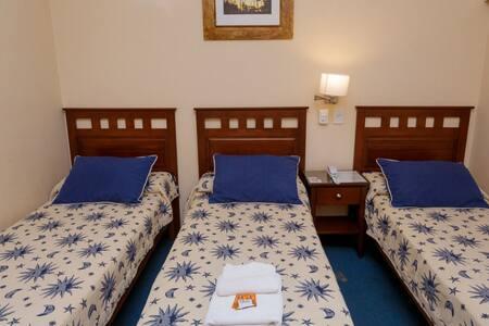 Hotel- Habitación triple individual