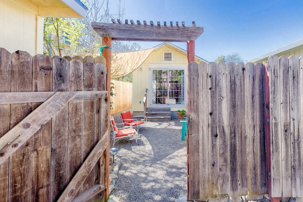 Enter through this gated fence and access the cottage door just a couple steps away