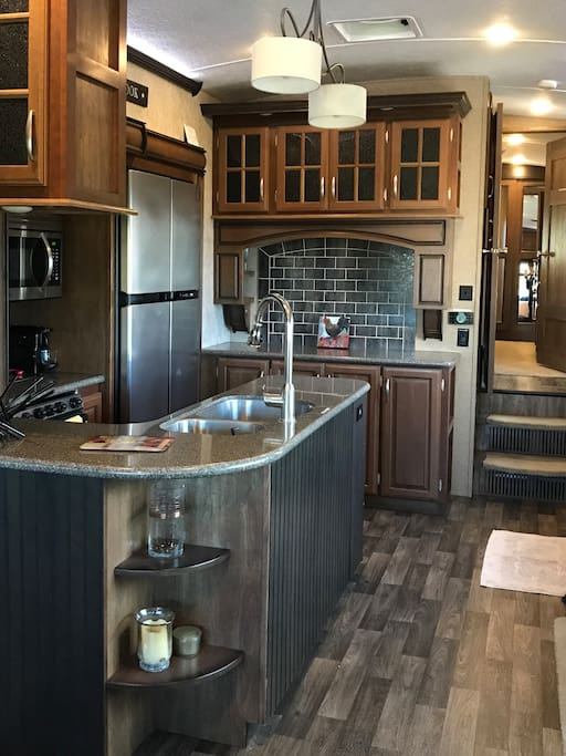 Full kitchen with microwave, refrigerator, oven, coffee machines, etc.