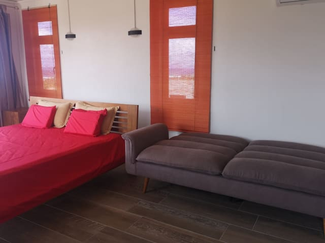 Master bedroom with sofabed