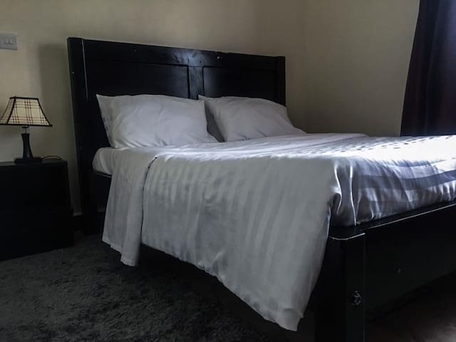 bedroom with double size bed beautifully laid with white linen