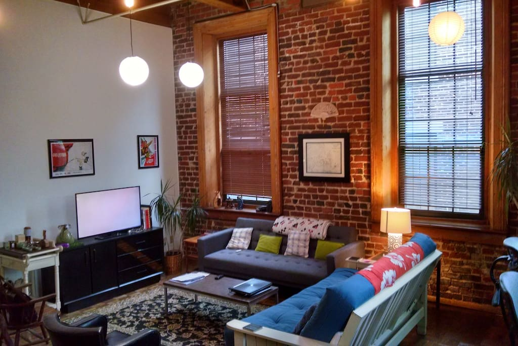 Common Room with exposed brick walls, timber frame and parquet wood floors