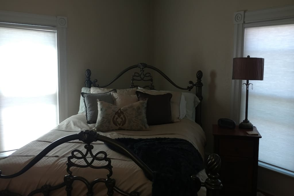 Master bedroom with down comforter and Pikes Peak view.
