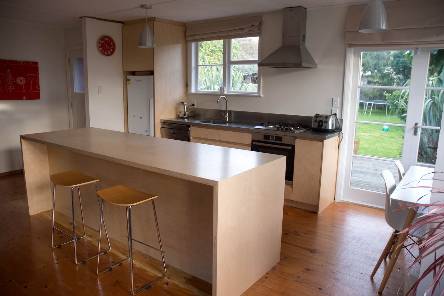 Brand new designer kitchen. Open plan living with french doors onto a large sunny deck.