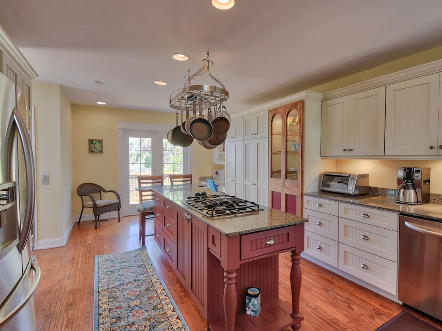 The chef in your party will appreciate the gorgeous, updated kitchen with stainless steel appliances, granite counters, and an expansive island for food prep.