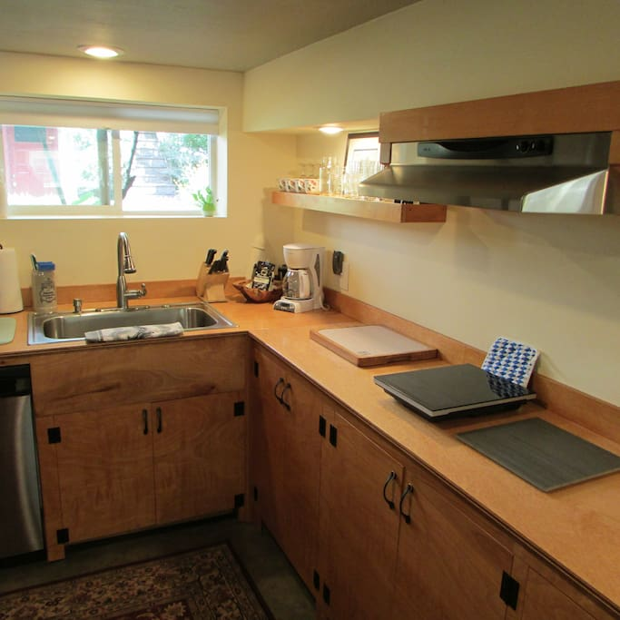 Kitchen amenities include induction cooktop with range hood, microwave, crock pot, toaster, etc.
