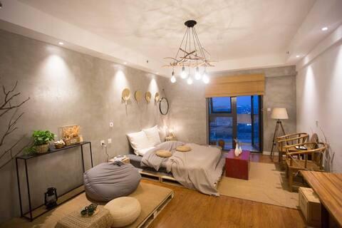 阳光100|禅意的家|大阳台|投影|吊床|近泰华万达银座|栖夕民宿
