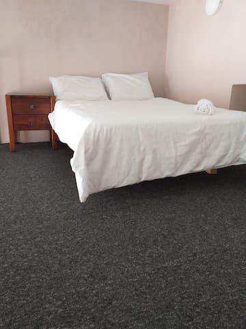 Bedroom 2 - sleeps 2 guests on a queen size bed