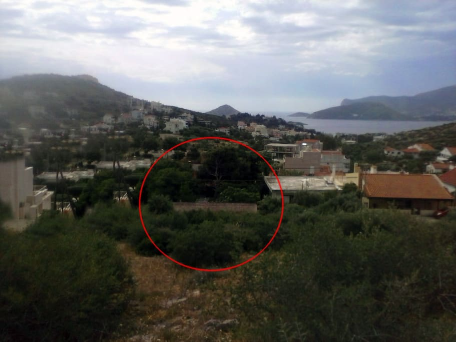 View of the house from the back mountain. With the red circle, the location of the house
