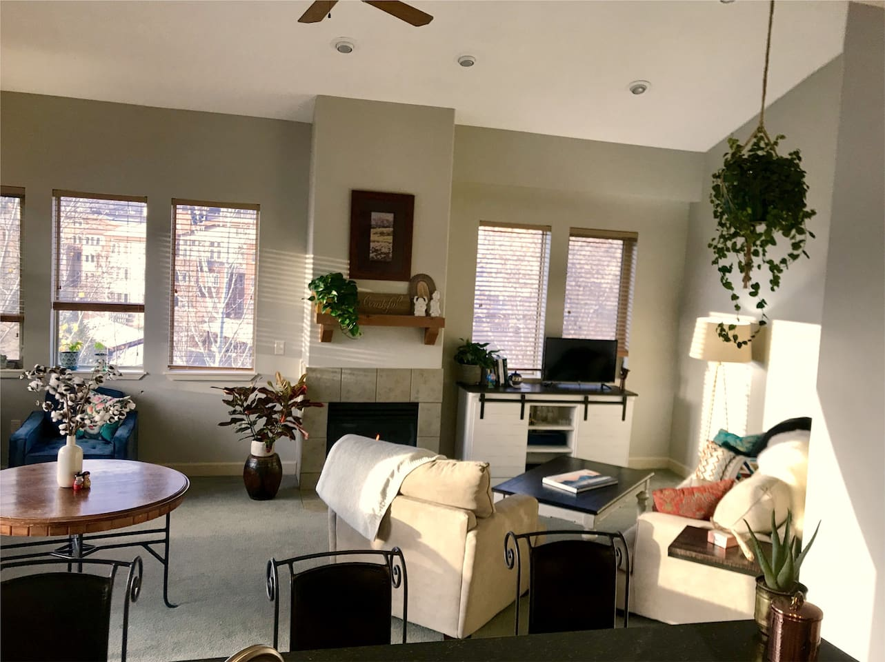 My cozy living room is a great place to sit by the fire, share adventures and good conversation with friends and family. East and south facing windows provide tons of sunlight and a view of Park City Mountain Resort!