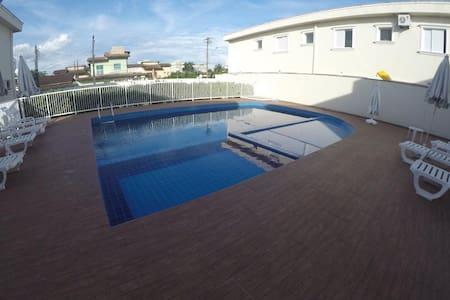 Casa em condomínio a 100 m da praia - Bertioga/SP - Bertioga - House