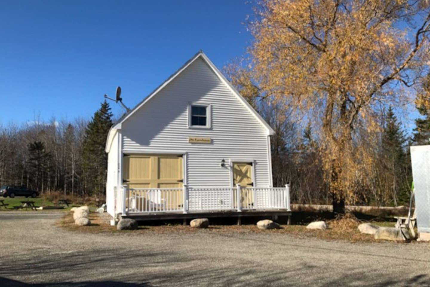 The Old Farmhouse Carriage House - deck with seating and access to the side yard with additional seating area.