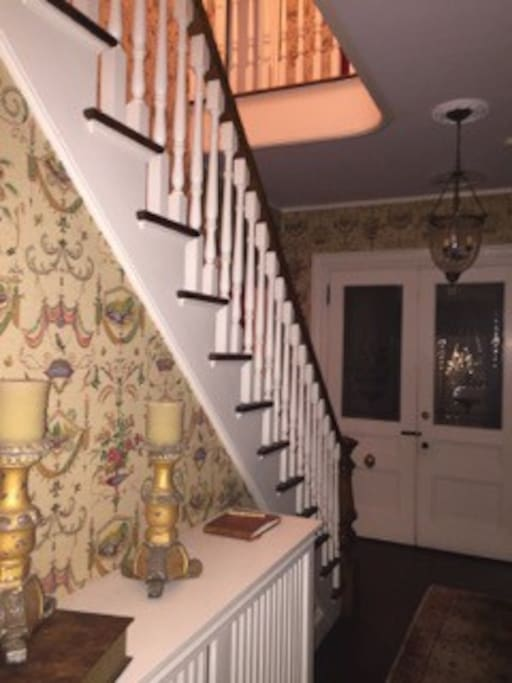 The Front Hallway and stairs leading up to the 2 adjoining bedrooms.