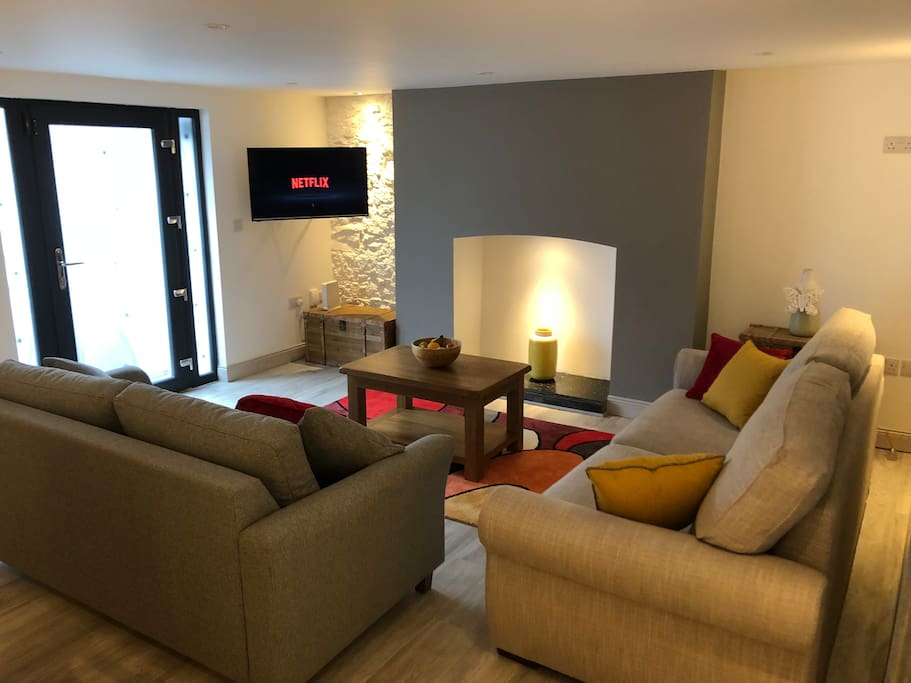 Open plan living/dining room with sofa which can be transformed into a large double bed. Netflix & satellite TV also available.