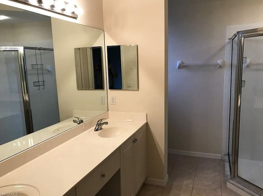 Master Bathroom with double vanity and walk in shower