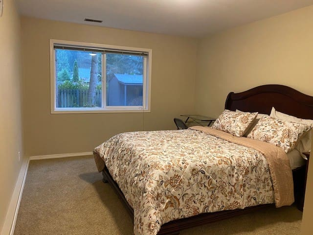 Bedroom with queen bed and beautiful view of the backyard