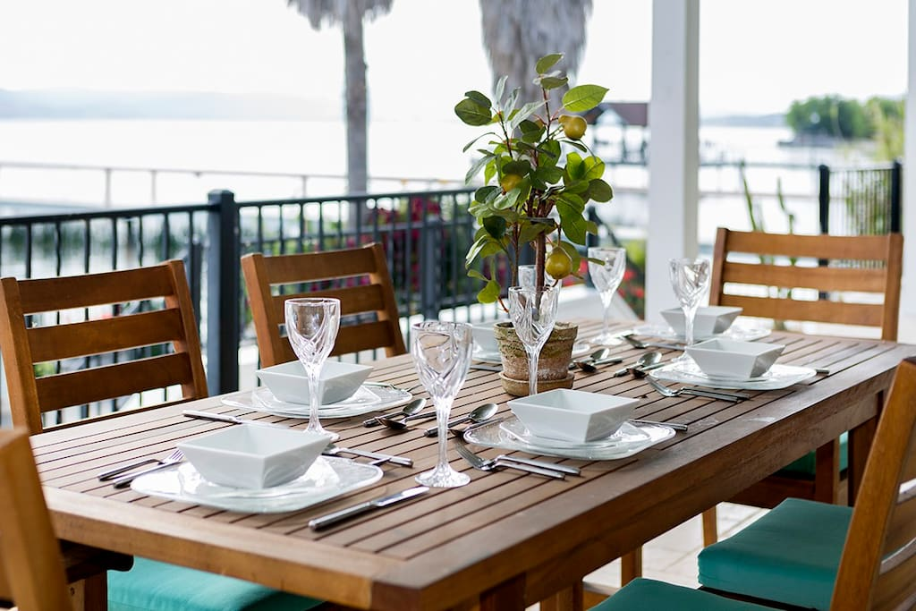 Dine al fresco overlooking the sparkling Clear Lake from our spacious outdoor dining room and patio.