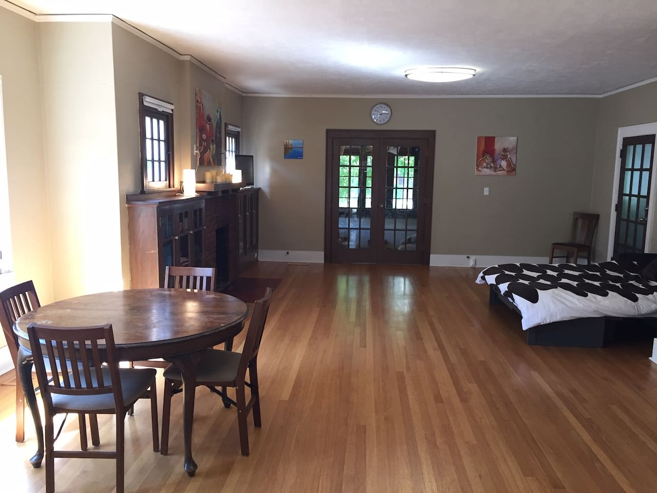 Studio space with queen bed and dining table. Additional air mattress can accommodate 2 more adults.
