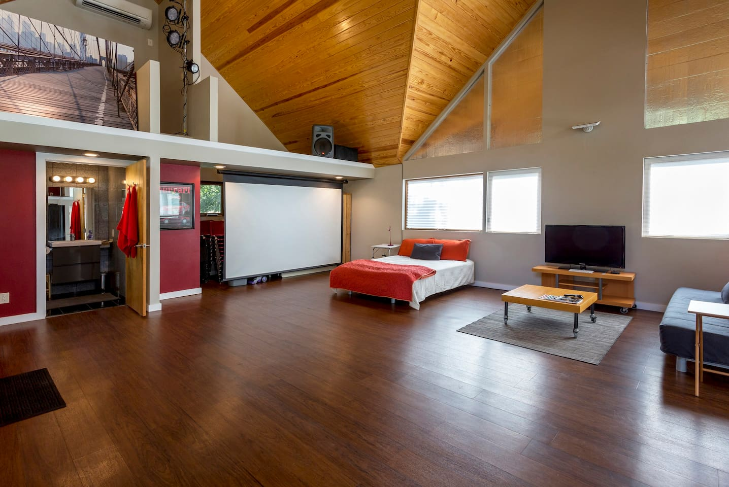 Wide open loft styling with vaulted wood ceilings.