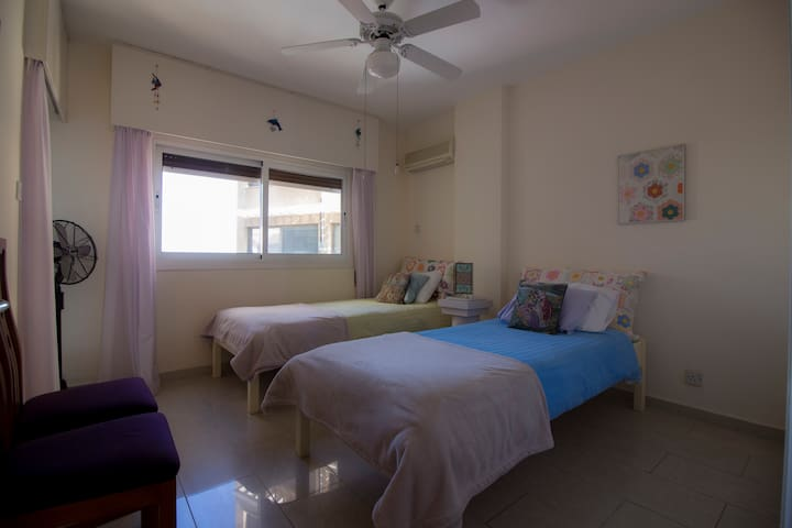 Bedroom with two single beds, 200 x 90cm mattresses and a sea view.