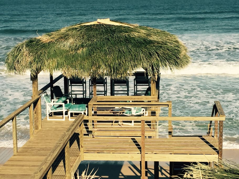 Second Tiki Hut at the end of the dock with the waves crashing beneath.